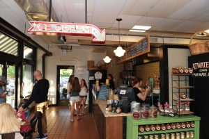 Inside Belvedere Square Market where customers can order savory and sweet foods.