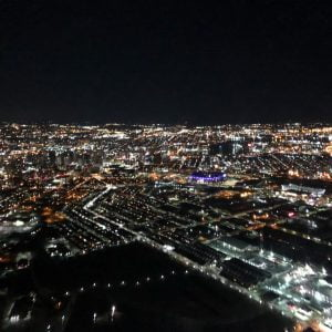 Aerial night view overlooking Baltimore City from a helicopter from Charm City Helicopters.