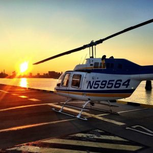 Helicopter landing during sunset in Baltimore City.