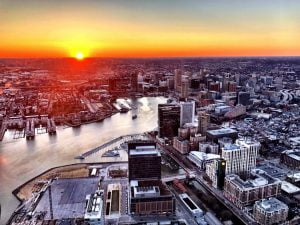 Aerial view of Baltimore City during sunset from a helicopter provided by Charm City Helicopters.