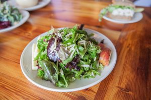 Atwater's leafy green salad with apples, located in Belvedere Square.