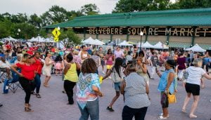 People dancing to live music during a summer day in Belvedere Square.