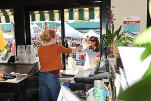 Girl giving a woman her smoothie from the window of Plantnbar in Belvedere Square.
