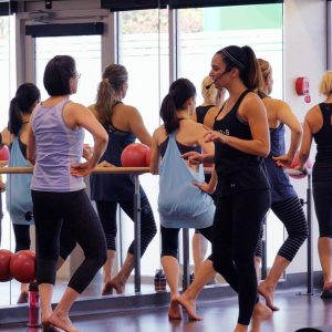 Woman teaching women's group fitness classes at Lynne Brick's in Belvedere Square.