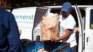 Cornerstones volunteers transporting food