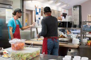 cornerstones volunteers preparing food as donations
