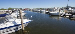 Boats on the water outside of MarineMax Baltimore where Scott Plank invests in a boatel.